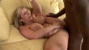 Busty blonde milf fucks a big black shaft in every position