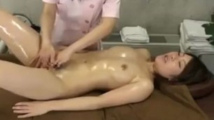 Asian girl has a masseuse driving her honey hole