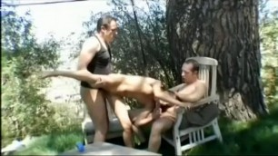Appealing blonde girl enjoys a double dicking in an outdoor scene