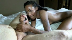 dark haired girl indulges his cock with his hands