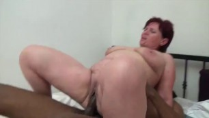 Insatiable Redhead Granny goes black