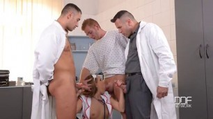 Two doctors and a patient in the hospital fucked insatiable girl