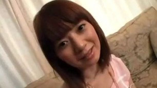 Delightful Japanese girl with a pretty smile exposes