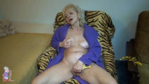 This old granny plays with her pussy solo