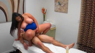 Chesty Babe Jhenevieve Straddles Her Client On the massage couch