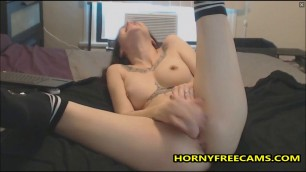 Cute Tattooed Babe Really Loves Toying Pussy